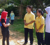 Koh Yao Noi Youth Guides show the Ban Talae Nok Youth Conservation Group around their school and environmental projects