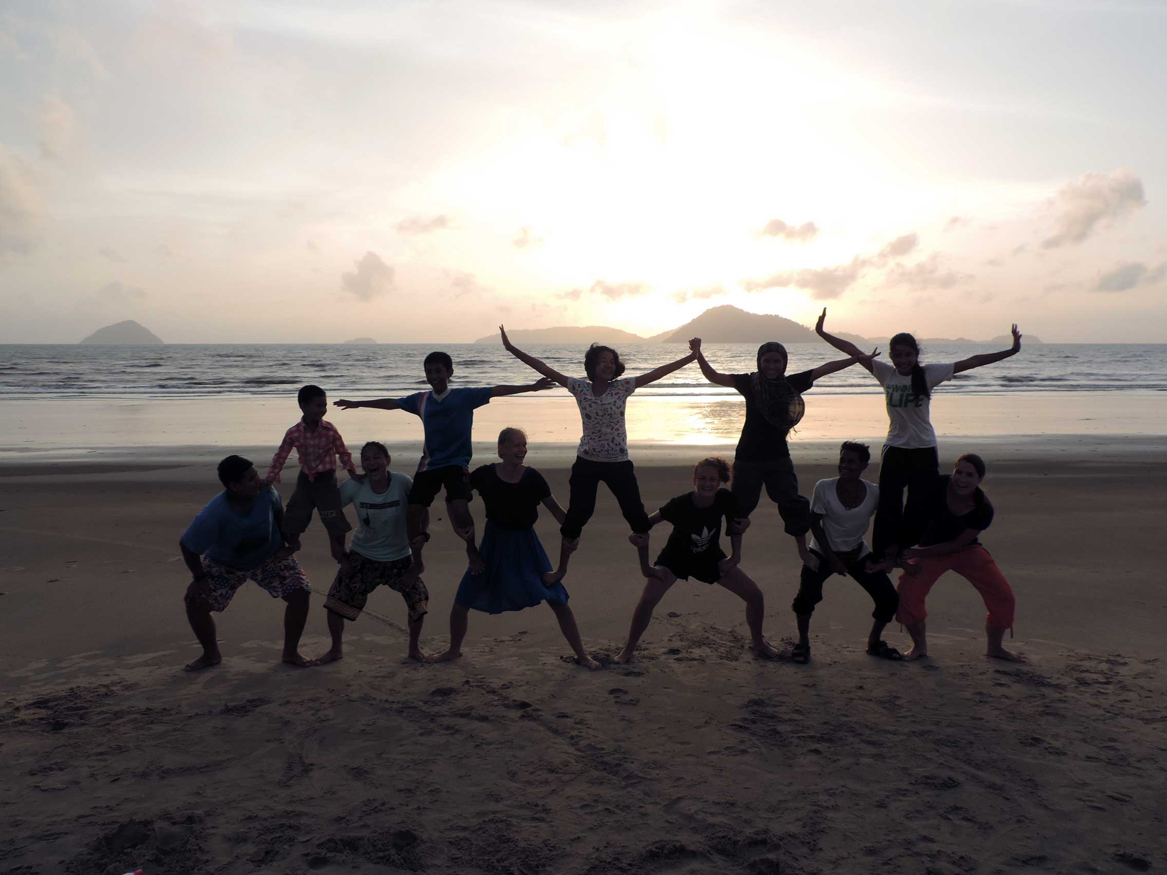 Gymnastics on the beach with homestay hosts