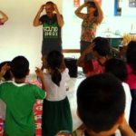 volunteers in thailand dance with Thai students