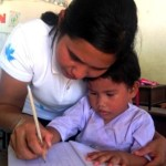 First Grader with the new female teacher at the Migrant Education Program Kuraburi, Phang Nga